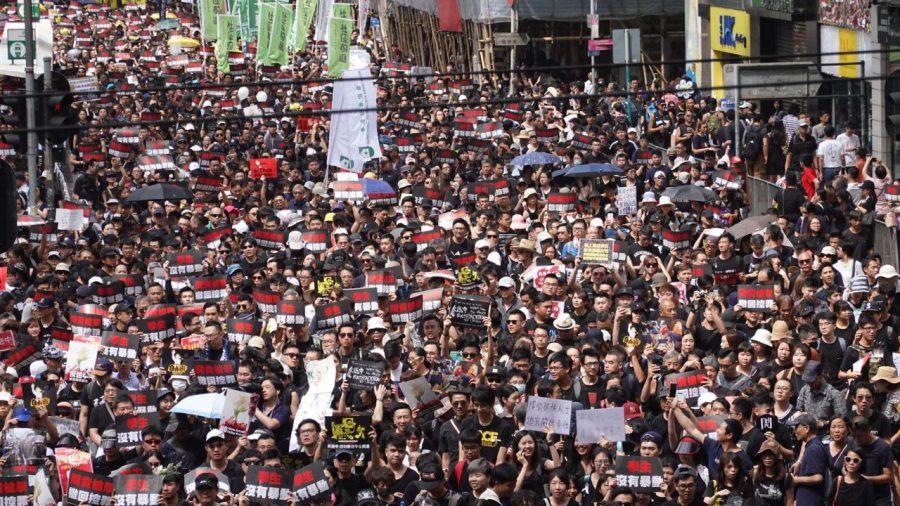 'Sea of Black:' Hong Kong Protesters Demand Leader Step Down