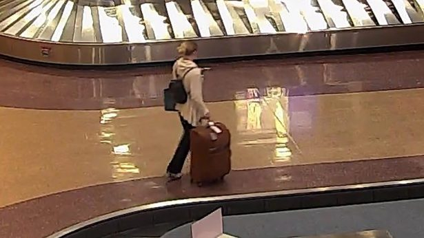 Lueck carries her luggage through Salt Lake City International Airport