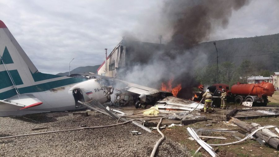 Plane Skids Off Runway, Killing 2 Crew Members and Injuring Dozens of Passengers