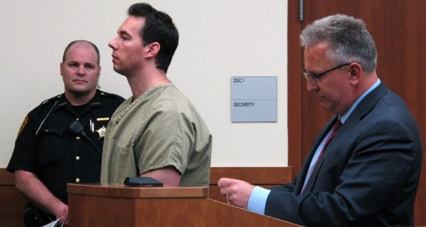 The former critical care doctor William Husel, center, pleads not guilty to murder charges