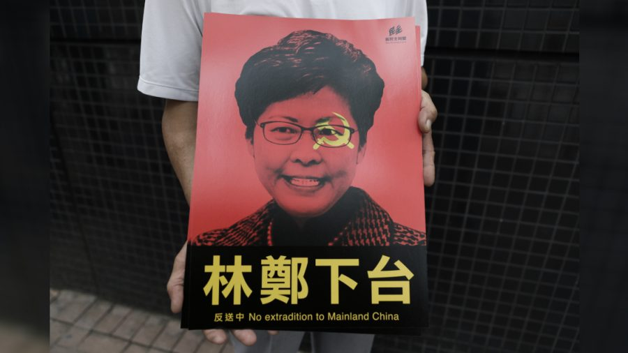 Activists Call for Hong Kong Leader Carrie Lam to Resign After She Suspends Bill