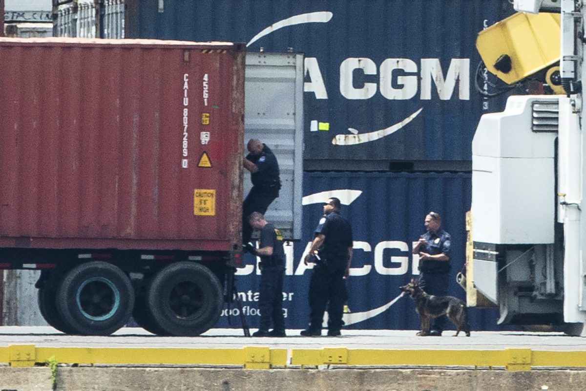 Authorities search a container