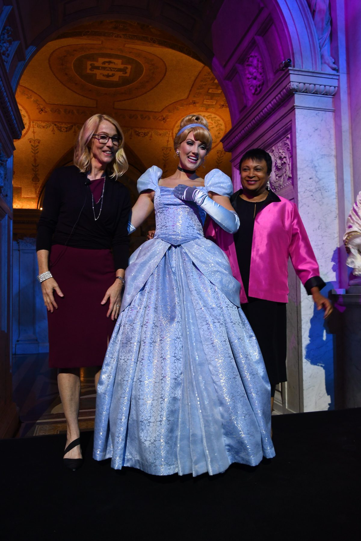 Costumed Cinderella poses with Mary Walsh