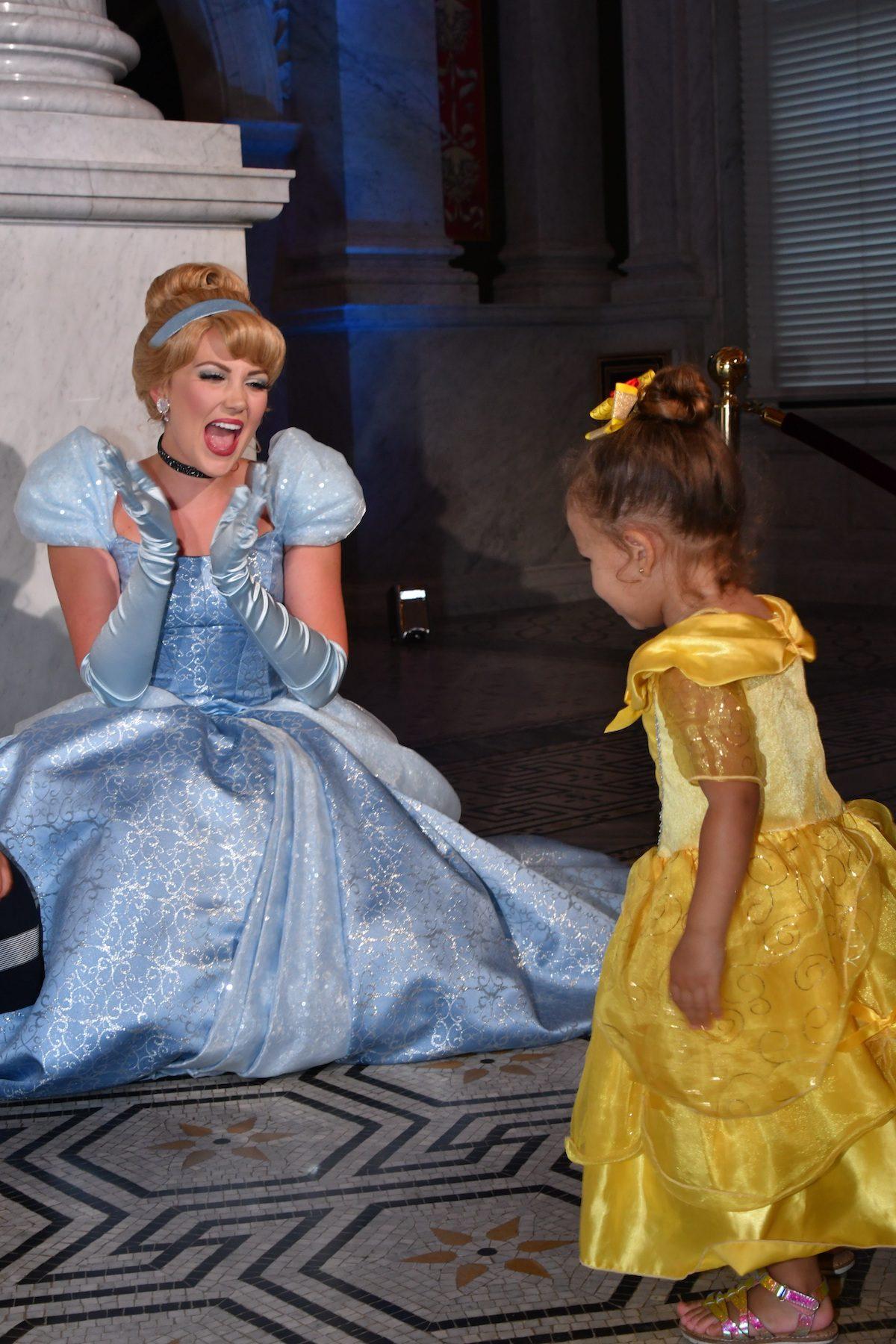 Costumed Cinderella greets a young guest