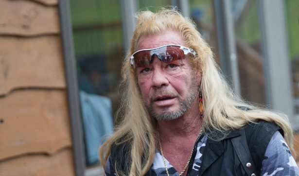 Dog the Bounty Hunter, Duane Chapman films a segment of his television show outside of a news conference