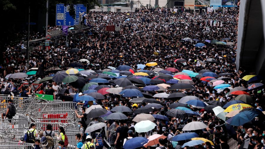 Hong Kong Cancels Debate on Extradition Bill After Protests Erupt