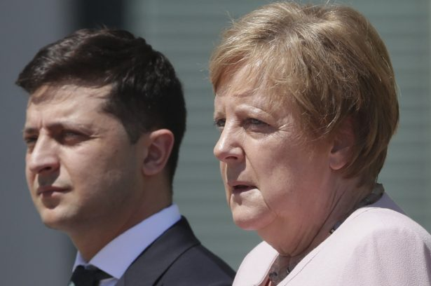 German Chancellor Angela Merkel welcomes Ukraine's President Volodymyr Zelenskiy with military honors for a meeting