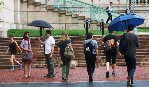 People walk on the Columbia University campus in New York City,