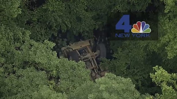 A light medium tactical vehicle sits overturned near the Camp Natural Bridge summer military training camp off Route 293,