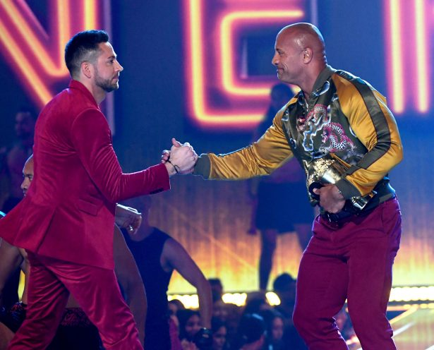 (L-R) Zachary Levi presents Dwayne Johnson with the MTV Generation Award