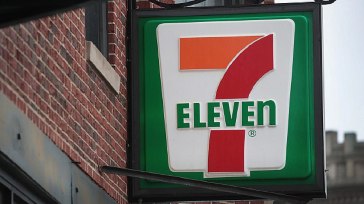 A sign hangs outside of a 7-Eleven store on in Chicago,
