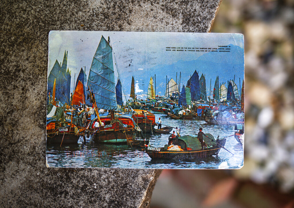A postcard, which depicts a scene of fishing boats in Hong Kong