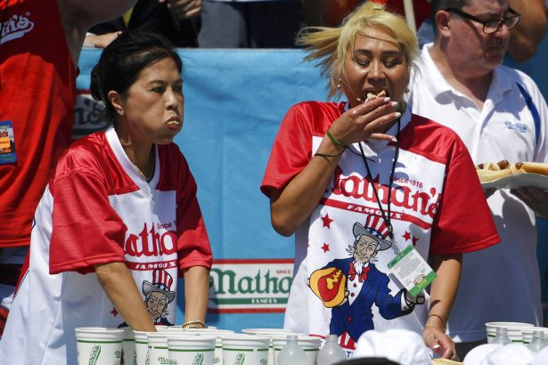 Juliet Lee, left, and Miki Sudo, right, compete in the women's competition