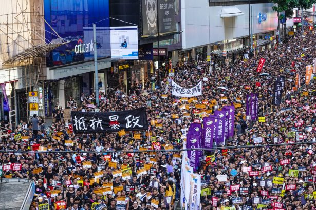 Hong Kong protesters marching on the street on July 1. (The Epoch Times)