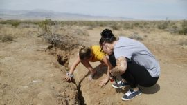 People Take Pictures Near and Inside Cracks Left by California Earthquake