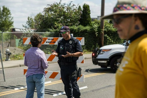 Police Officer Sam Lopez turns away would-be protesters