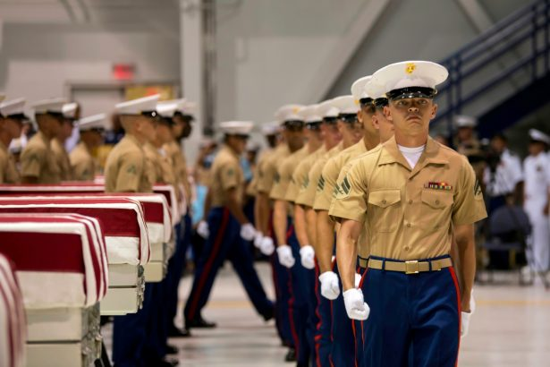 Marines march pass transfer cases