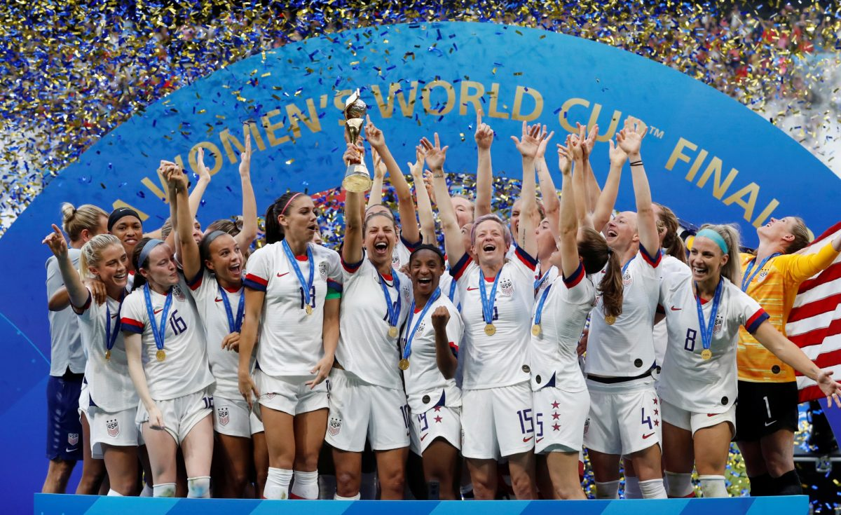 US team mates celebrate winning the women's world cup