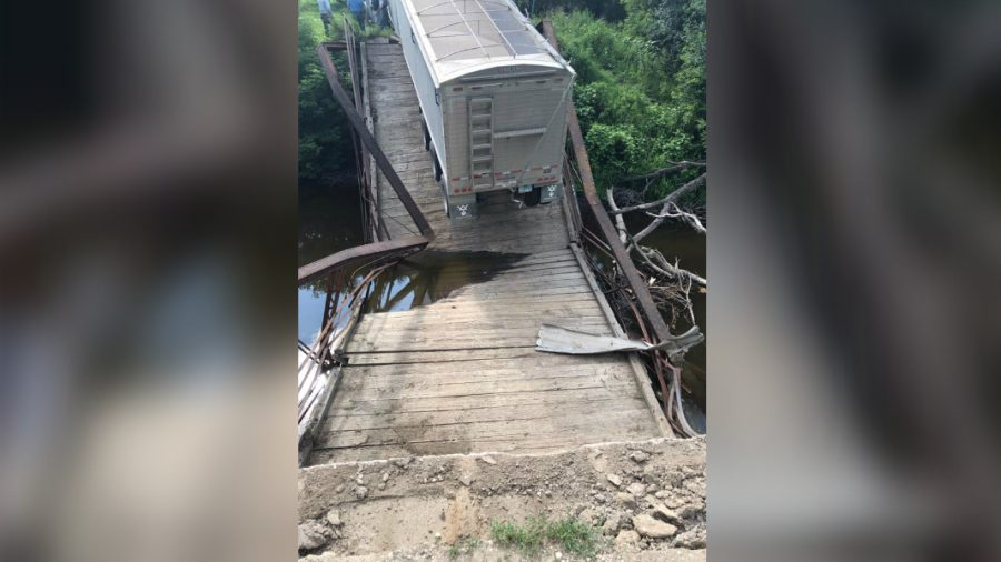 Pictured: 100-Year-Old Bridge Collapses Under Semitruck Nearly Four