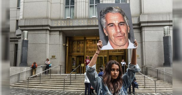 "protest group called ""Hot Mess"" hold up signs of Jeffrey Epstein"