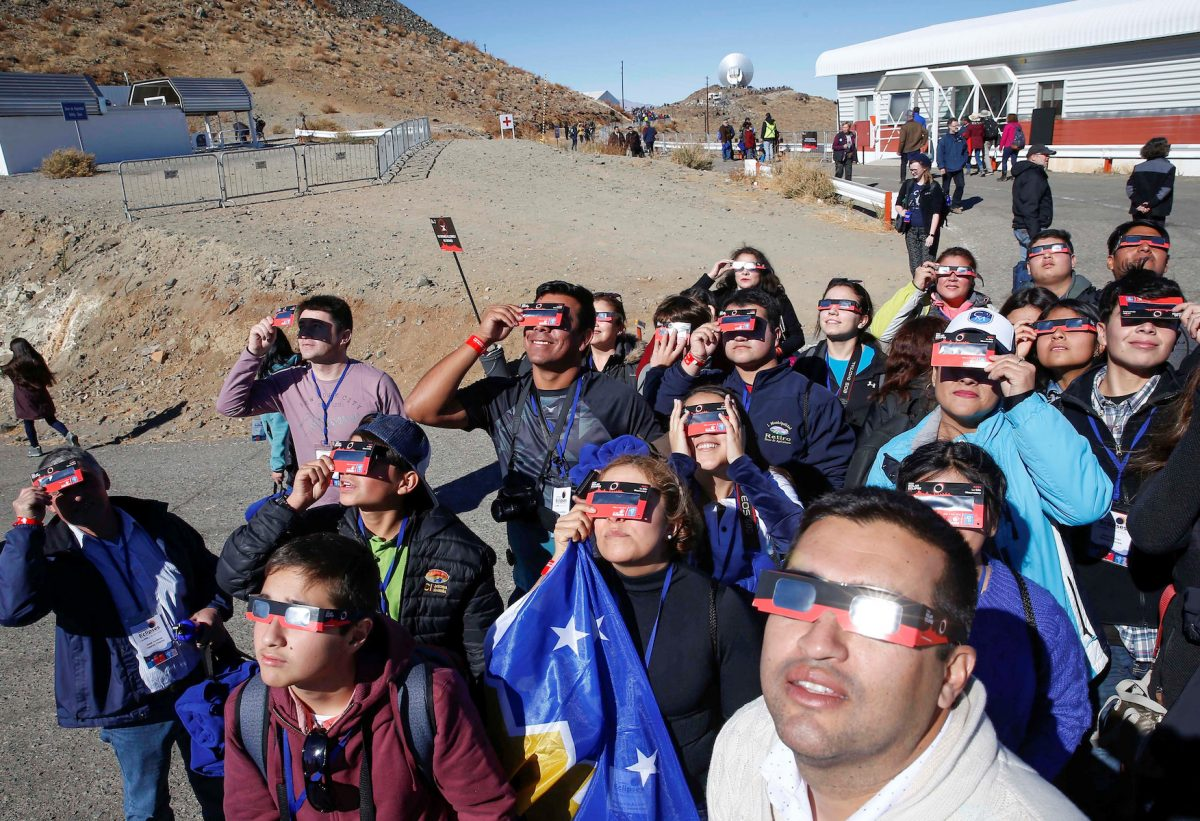 People test their special solar glasses before the solar eclipse in La Silla European Southern Observatory (ESO) at Coquimbo