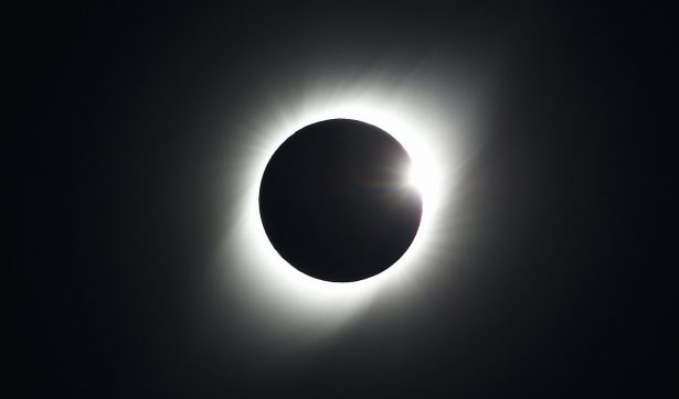 Chileans, Argentines Gape at Total Solar Eclipse in Rare, Irresistible Event