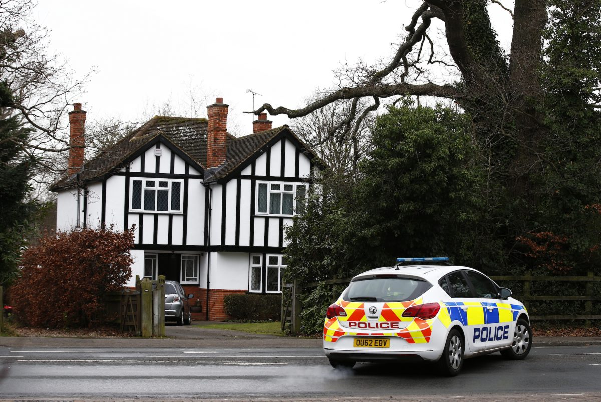 A police car drives past an address which has been linked by local media to former British intelligence officer Christopher Steele, who has been named as the author of an intelligence dossier on President-elect Donald Trump, in Wokingham