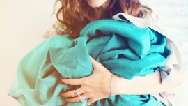 Woman's Viral Hack to Folding Fitted Sheets in One Minute Sparks Internet Debate