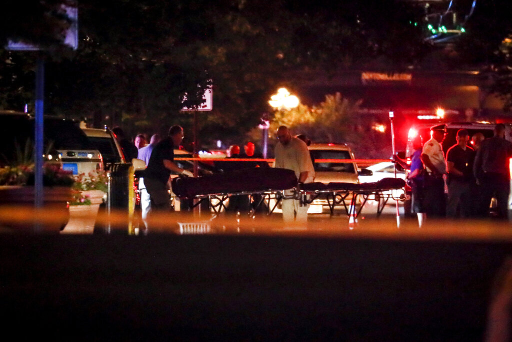 Bodies are removed from at the scene of the mass shooting in Ohio