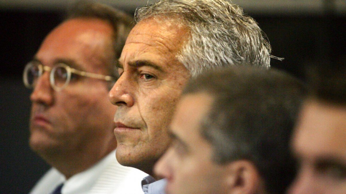 Jeffrey Epstein, center, appears in court in West Palm Beach