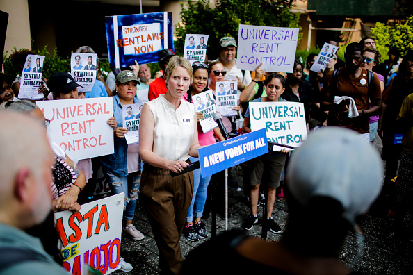 Then Democratic gubernatorial candidate Cynthia Nixon speaks to attendees during a rally for universal rent control on August 16, 2018 in New York City. Cynthia Nixon, who is running against Gov. Andrew M. Cuomo for the governor seat has pushed for a more response to high rents, also, Nixon has said that cities throughout the state should be allowed to impose it. Only NYC and some nearby areas are allowed to impose rent control, and only on apartments built before 1974. (Photo by Eduardo Munoz Alvarez/Getty Images)