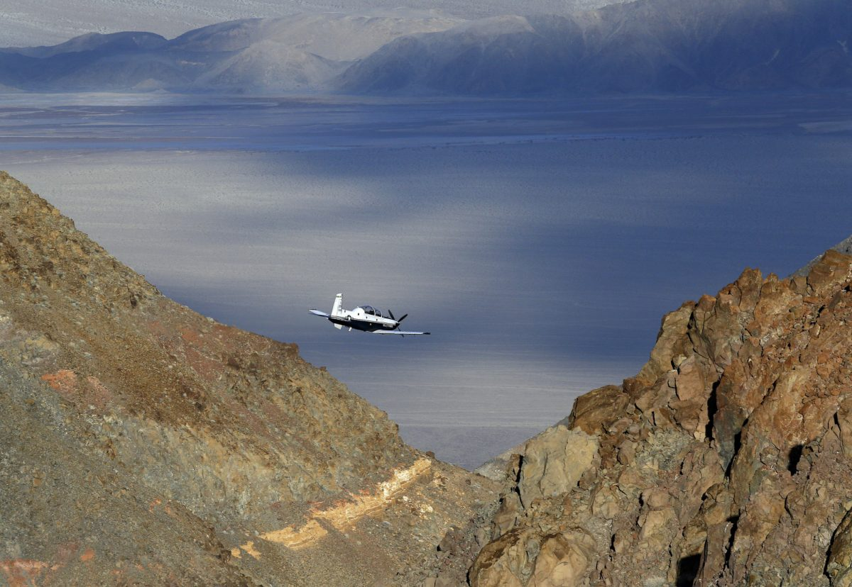 Plane flying in Death Valley