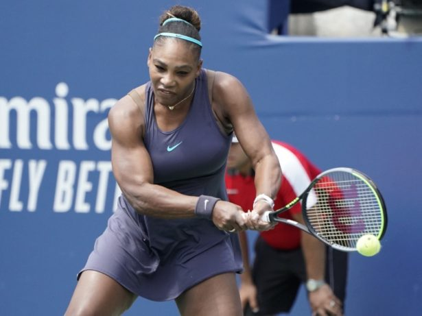 Serena Williams hits a ball at Rogers Cup final