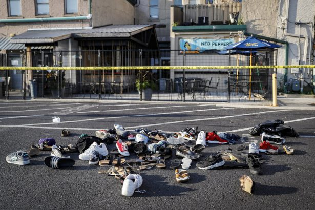 Shoes are piled outside the scene of a mass shooting