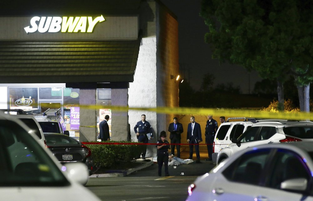 Police work the scene of a stabbing
