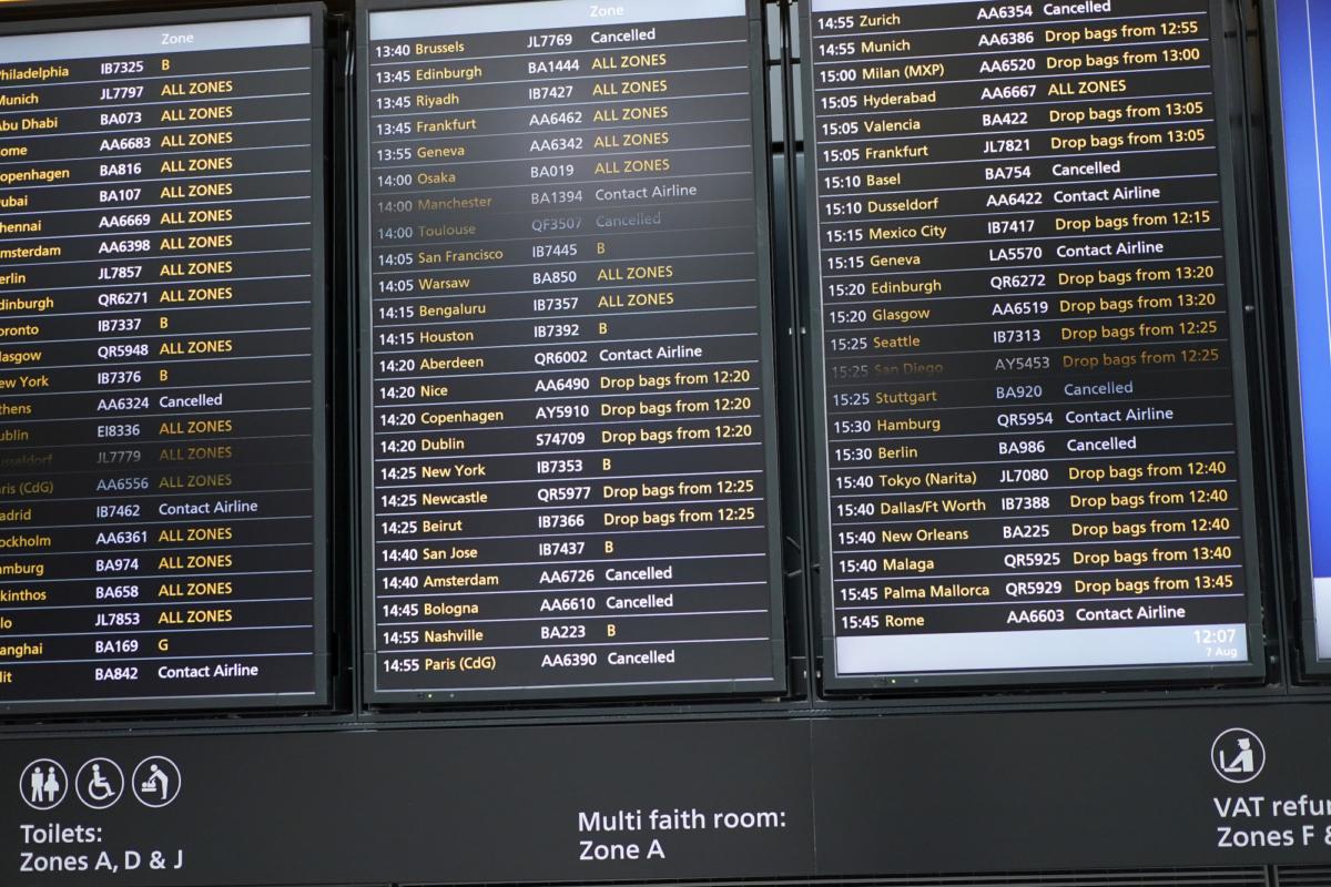 A flight information screen inside Terminal 5