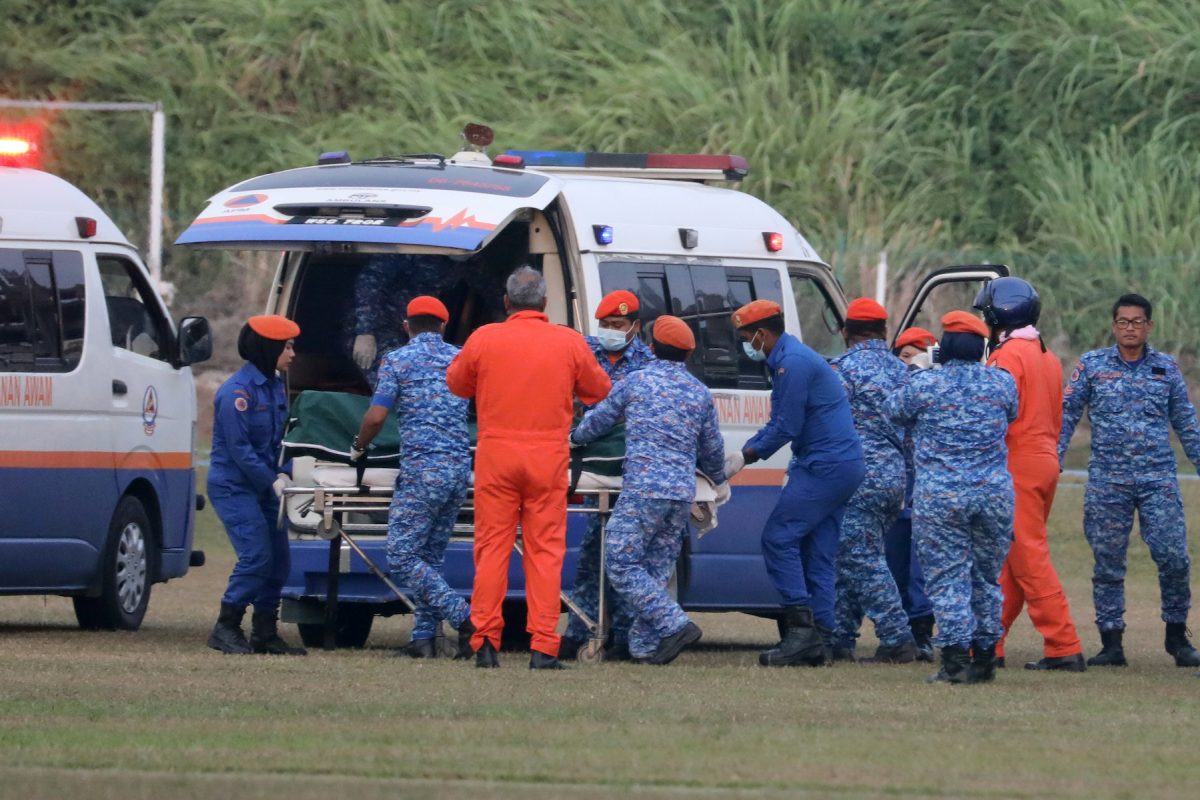 FILE PHOTO: A body believed to be 15-year-old Irish girl Nora Anne Quoirin who went missing is brought into a ambulance in Seremban
