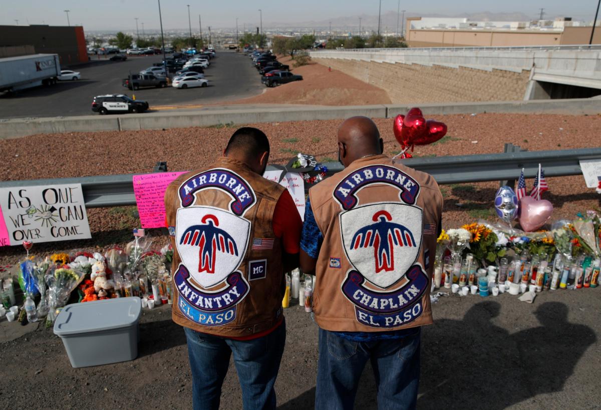 People pray a makeshift memorial