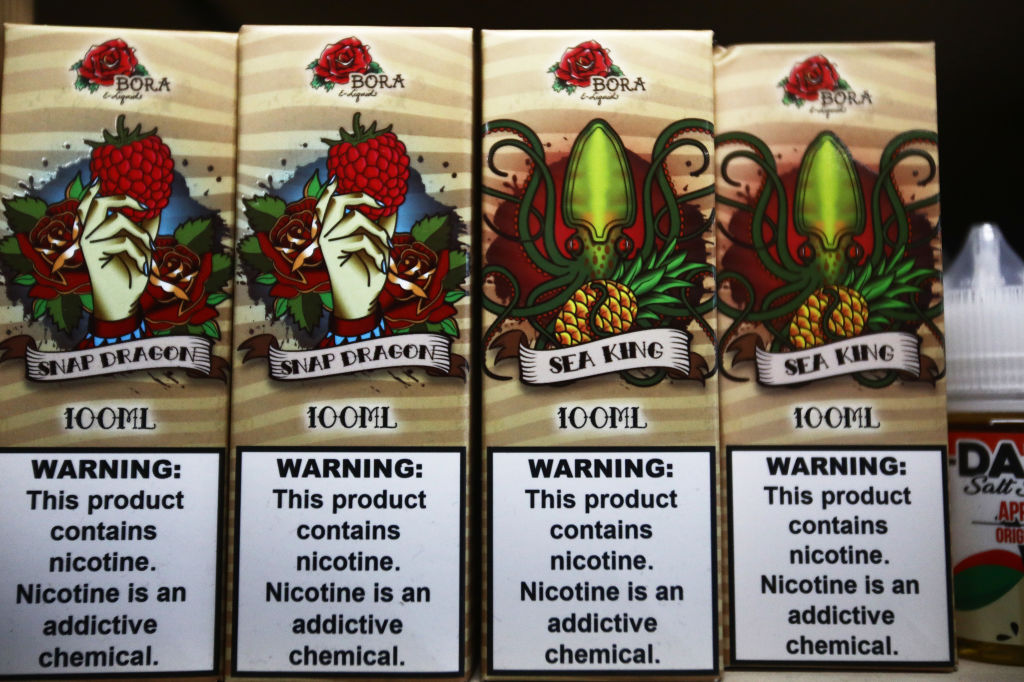 E-liquids are displayed for sale, with nicotine warning labels, in a vape shop on September 06, 2019 in Los Angeles, California. The CDC has advised against using e-cigarettes.