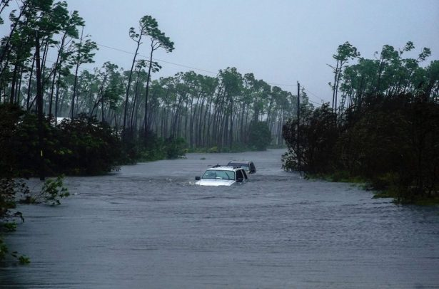 Cars sit submerged in water from Hurricane Dorian