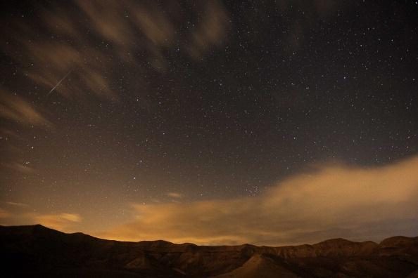 Geminid meteor streaks are seen above the Judean desert