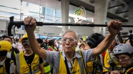 A Group of Parents and Elderly Protect Hong Kong Protesters During Police Clashes