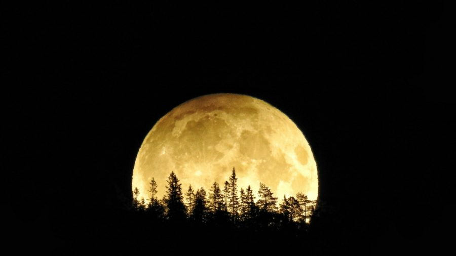 A Glowing Harvest Moon Will Light up Friday the 13th