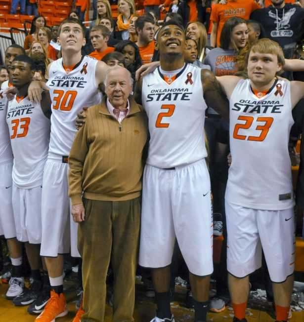 Oil tycoon and Oklahoma State supporter T. Boone Pickens, center, celebrates with Oklahoma State's basketball team