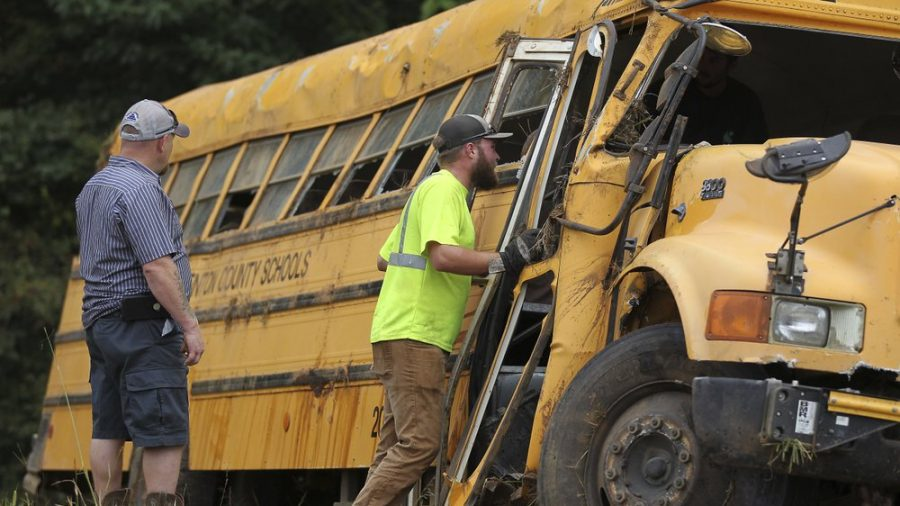 Driver Dies and 8 Children Are Injured as School Bus Crashes