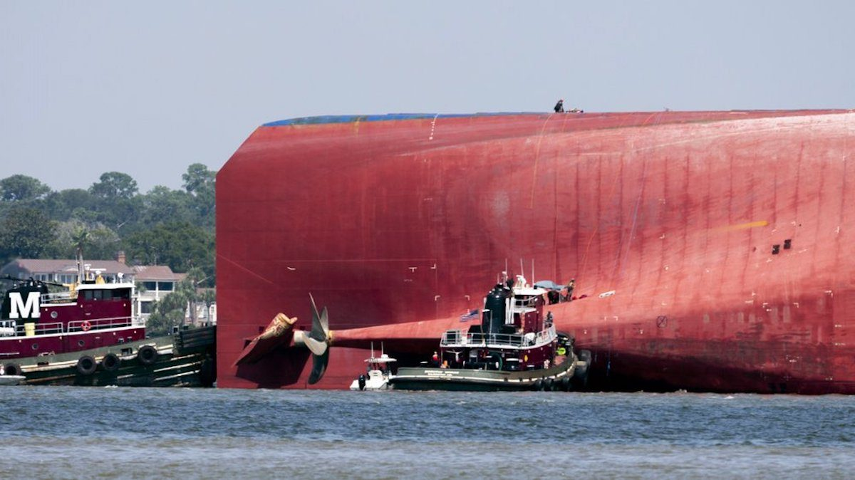 Rescuers work near the stern of the vessel Golden Ray