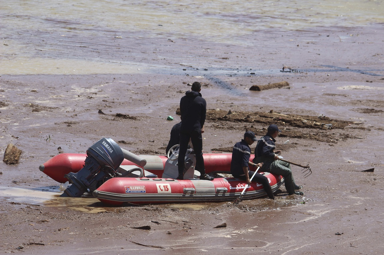 A rescue boat navigates the site of a bus crash in the town of Errachidia