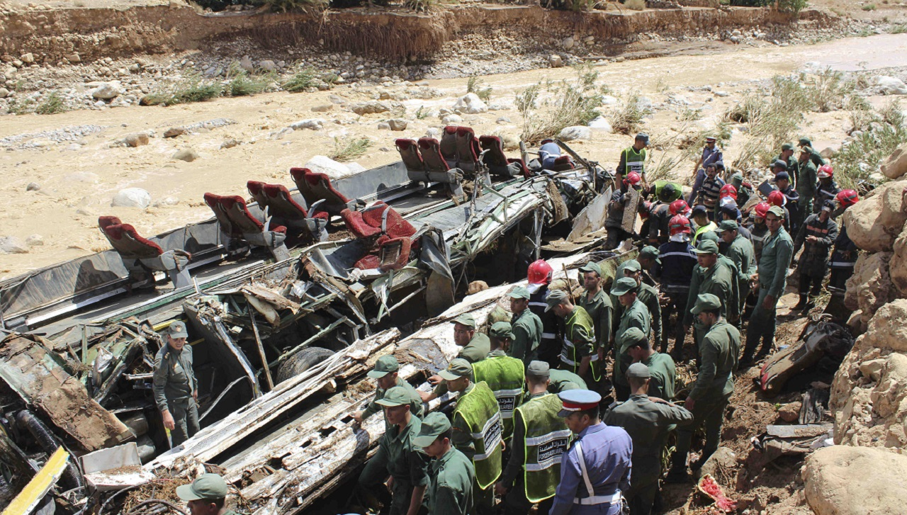 Security forces gather at the site of a bus crash in the town of Errachidia,