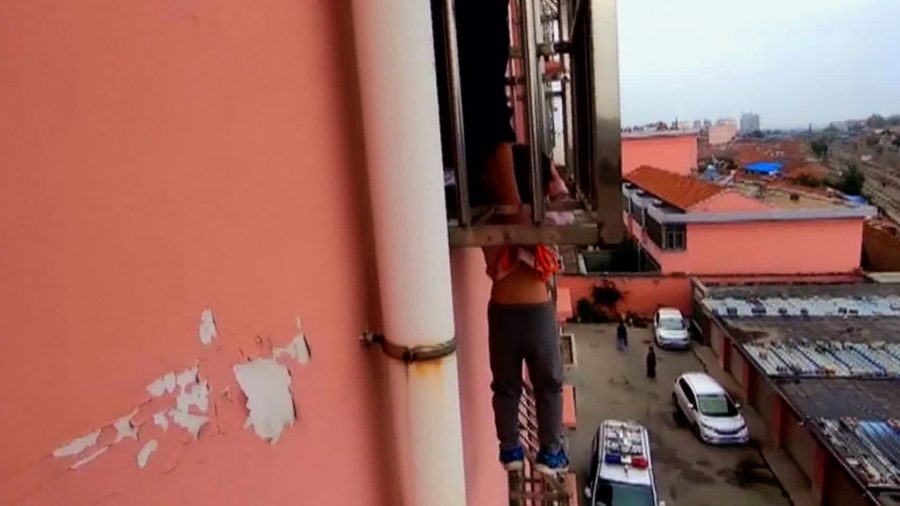 Chinese Boy, 4, Dangles From Fourth-Story Window After Head Gets Stuck