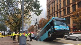 A Bus Falls Backward Into a Gaping Sinkhole in Pittsburgh